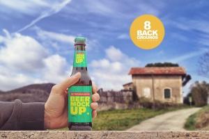 手持啤酒瓶外观印刷图案设计预览样机模板 Rustic Beer Mockup插图1